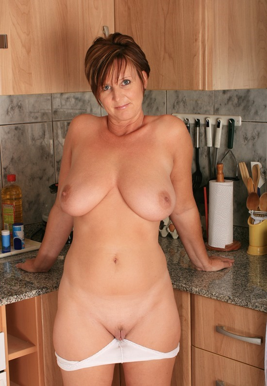 housewife-stripping-in-the-kitchen